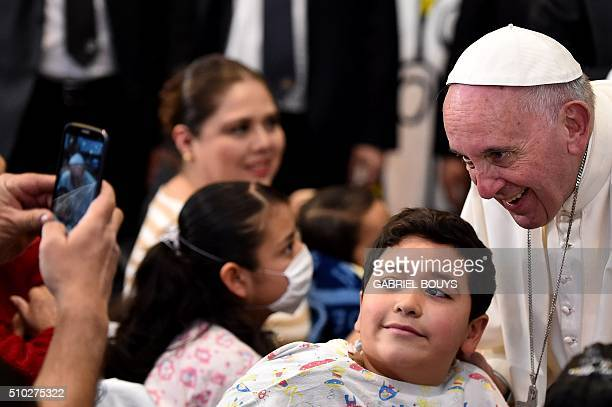 Pope Francis is photographed with a little patient during his visit to the Federico Gómez children's hospital in Mexico on February 14 2016Pope...