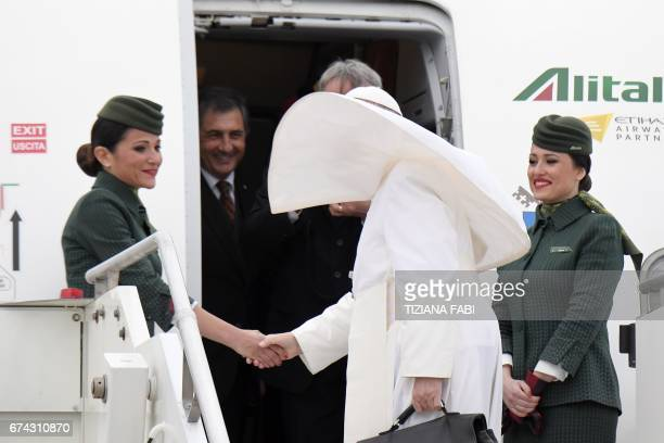 Pope Francis is welcomed by Alitalia's personnel prior his flight to Egypt on April 28 2017 at Rome's Fiumicino airport Pope Francis heads for a...