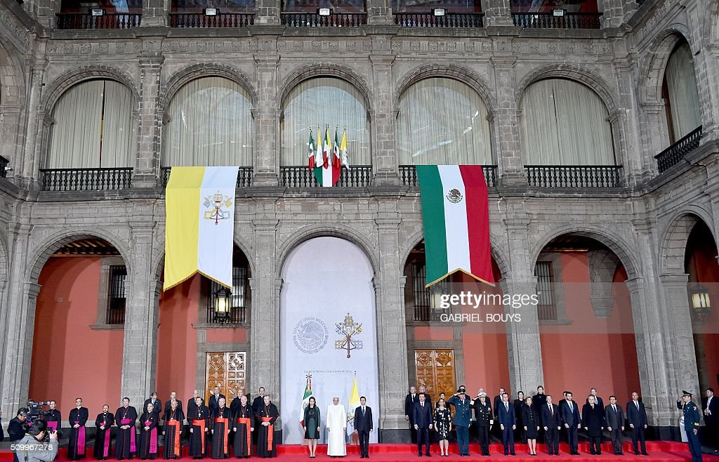 Pope Francis is welcomed by Mexican President Enrique Pena Nieto (R) and his wife Angelica Rivera, at the National Palace in Mexico on February 13, 2016. Francis on Saturday became the first pope to enter Mexico's National Palace to meet the president, marking a new step in church-state reconciliation in a staunchly Catholic nation hit by violence and poverty. AFP PHOTO / GABRIEL BOUYS / AFP / GABRIEL BOUYS