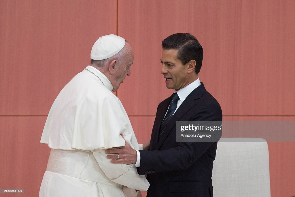 Pope Francis is welcomed by Mexico's president Enrique Pena Nieto (R) after delivering his message at National Palace on February 13, 2016 in Mexico City, Mexico.
