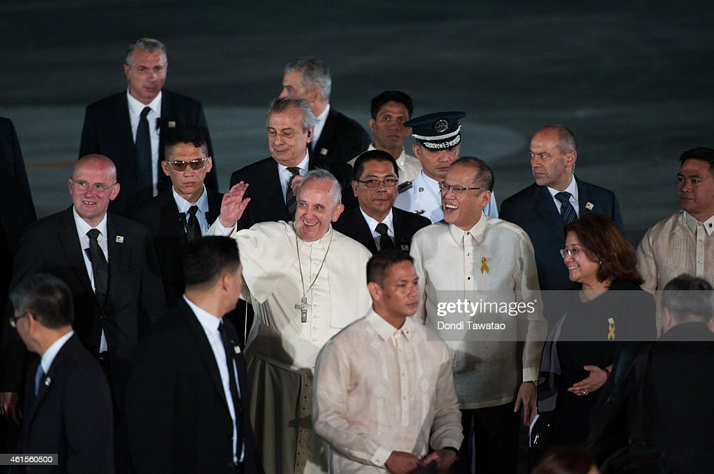 Pope Francis is welcomed by Philippine President Benigno Aquino (Center R) upon his arrival at Villamor airbase on January 15, 2015 in Manila, Philippines. Pope Francis will visit venues across Leyte and Manila during his visit to the Philippines from January 15 - 19. The visit is expected to attract crowds in the millions as Filipino Catholics flock to catch a glimpse of the leader of the Catholic Church in the Philippines for the first time since 1995. The Pope will begin the tour in Manila, then travelling to Tacloban to visit areas devastated by Typhoon Haiyan before returning to Manila to hold a mass at Rizal Park. The Philippines is the only Catholic majority nation in Asia with around 90 percent of the population professing the faith.