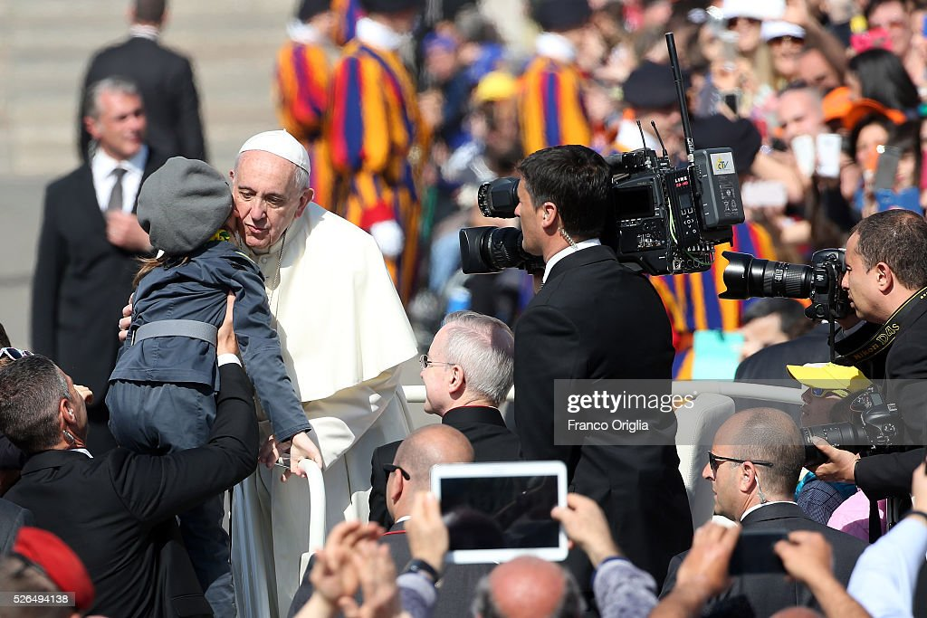 Pope Francis kisses a baby as he arrives in St. Peter's Square for a Jubilee Audience on April 30, 2016 in Vatican City, Vatican. Pope Francis held an extraordinary Jubilee Audience in St. Peter's Square for thousands of eager pilgrims. The Audience also celebrated the Jubilee for members of the police and armed forces.