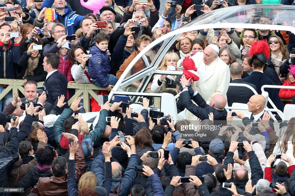 <a gi-track='captionPersonalityLinkClicked' href=/galleries/search?phrase=Pope+Francis&family=editorial&specificpeople=2499404 ng-click='$event.stopPropagation()'>Pope Francis</a> kisses a baby as he leaves on the popemobile during the end of the Solemnity of Christ the King in St. Peter's square on November 24, 2013 in Vatican City, Vatican. Today's solemnity of Our Lord Jesus Christ, King of the Universe, the crowning of the liturgical year, marks the conclusion of the Year of Faith proclaimed earlier by Pope emeritus Benedict XVI in the last year of his reign.