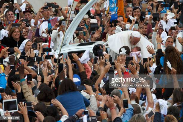Pope Francis kisses a baby as he leaves the Sanctuary of Fatima on May 13 2017 in Fatima Portugal Pope Francis is attending the Sanctuary of Fatima...
