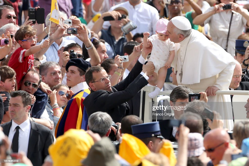 <a gi-track='captionPersonalityLinkClicked' href=/galleries/search?phrase=Pope+Francis&family=editorial&specificpeople=2499404 ng-click='$event.stopPropagation()'>Pope Francis</a> kisses a child as he arrives in St. Peter's Square for his Weekly Audience on May 1, 2013 in Vatican City, Vatican. Marking the feast of St Joseph the Worker and World Labor Day this Wednesday May 1st, the Pontiff launched an urgent appeal to Christians and men and women of goodwill worldwide to take decisive steps to end slave labor.