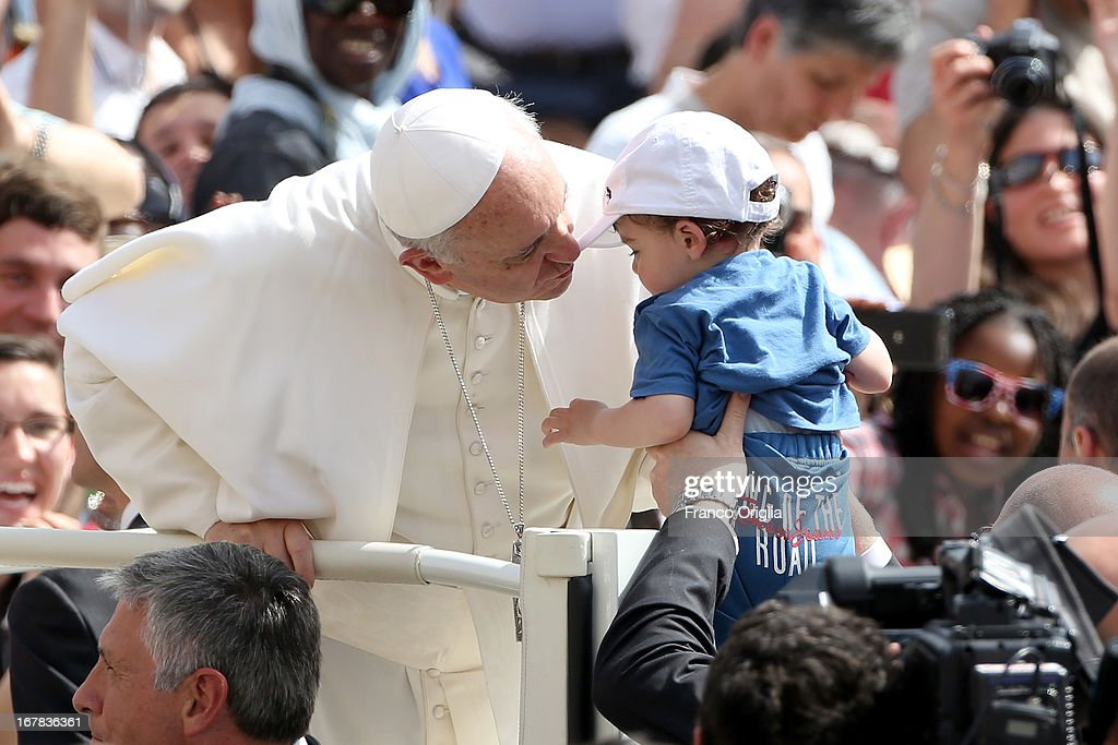 <a gi-track='captionPersonalityLinkClicked' href=/galleries/search?phrase=Pope+Francis&family=editorial&specificpeople=2499404 ng-click='$event.stopPropagation()'>Pope Francis</a> kisses a child as he arrives in St. Peter's Square for his Weekly Audience on May 1, 2013 in Vatican City, Vatican. Marking the feast of St Joseph the Worker and World Labor Day today, the Pontiff launched an urgent appeal to Christians and men and women of goodwill worldwide to take decisive steps to end slave labor.
