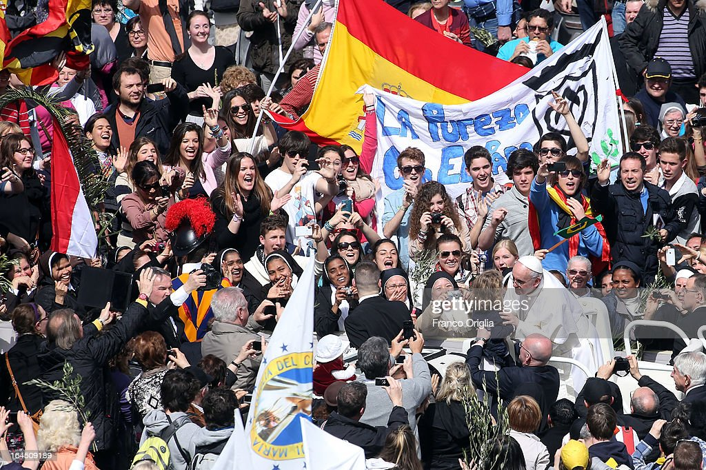 <a gi-track='captionPersonalityLinkClicked' href=/galleries/search?phrase=Pope+Francis&family=editorial&specificpeople=2499404 ng-click='$event.stopPropagation()'>Pope Francis</a> kisses a child as he greets the faithful after conducting Palm Sunday Mass on March 24, 2013 in Vatican City, Vatican. <a gi-track='captionPersonalityLinkClicked' href=/galleries/search?phrase=Pope+Francis&family=editorial&specificpeople=2499404 ng-click='$event.stopPropagation()'>Pope Francis</a> lead his first mass of Holy Week as pontiff by celebrating Palm Sunday in front of thousands of faithful and clergy. The pope's first holy week will also incorporate him washing the feet of prisoners in a youth detention centre in Rome next Thursday, 28th March.
