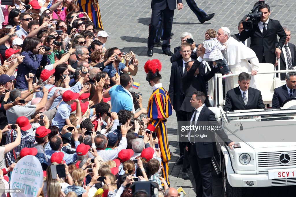 <a gi-track='captionPersonalityLinkClicked' href=/galleries/search?phrase=Pope+Francis&family=editorial&specificpeople=2499404 ng-click='$event.stopPropagation()'>Pope Francis</a> kisses a child as he leaves at the end of the Holy Mass and Canonization Ceremony at St. Peter's Square on May 12, 2013 in Vatican City, Vatican. The pontiff today canonized over 800 new saints; Antonio Primaldo and his companions, martyrs of Otranto in Italy; first Colombian Saint in history Laura di Santa Caterina da Siena Montoya y Upegui, virgin and foundress; and the Mexican Maria Guadalupe Garc'a Zavala, co-foundress.