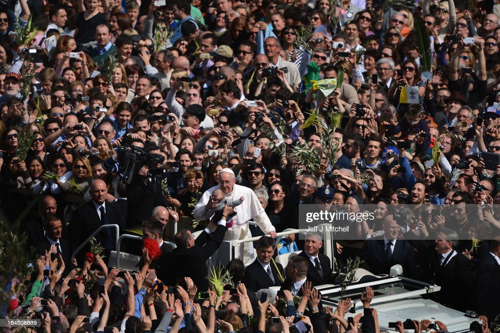 <a gi-track='captionPersonalityLinkClicked' href=/galleries/search?phrase=Pope+Francis&family=editorial&specificpeople=2499404 ng-click='$event.stopPropagation()'>Pope Francis</a> kisses a young child as he drives around St Peter's Square following the Palm Sunday Mass St Peter's Square following the Palm Sunday Mass on March 24, 2013 in Vatican City, Vatican. <a gi-track='captionPersonalityLinkClicked' href=/galleries/search?phrase=Pope+Francis&family=editorial&specificpeople=2499404 ng-click='$event.stopPropagation()'>Pope Francis</a> lead his first mass of Holy Week as pontiff by celebrating Palm Sunday in front of thousands of faithful and clergy. The pope's first holy week will also incorporate him washing the feet of prisoners in a youth detention centre in Rome next Thursday, 28th March.