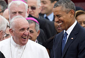 Pope Francis laughs alongside US President Barack Obama upon arrival at Andrews Air Force Base in Maryland September 22 on the start of a 3day trip...