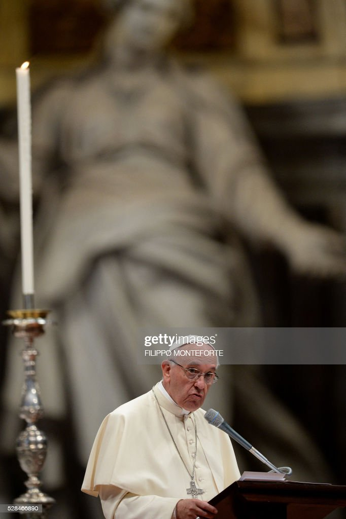 Pope Francis leads a prayer vigil 'To Dry the Tears' for people in suffering, to mark the Catholic feast of Ascension on May 5, 2016 at the Saint Peter Basilica in Vatican. / AFP / FILIPPO