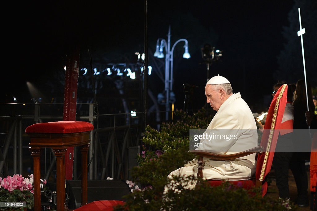 Pope Francis leads the celebration of the Way of the Cross on Good Friday on March 29, 2013 at the Colosseum in Rome. Pope Francis presided over his first Good Friday which will culminate in a torch-lit procession at Rome's Colosseum and prayers for peace in a Middle East 'torn apart by injustice and conflicts'. AFP PHOTO / GABRIEL BOUYS