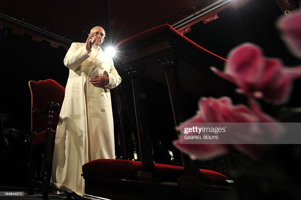 Pope Francis leads the celebration of the Way of the Cross on Good Friday on March 29, 2013 at the Colosseum in Rome. Pope Francis presided over his first Good Friday which will culminate in a torch-lit procession at Rome's Colosseum and prayers for peace in a Middle East 'torn apart by injustice and conflicts'.