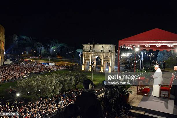 Pope Francis leads the 'Via Crucis' procession which commemorates the crucifixion of Jesus Christ at the Colosseum on Good Friday in Rome Italy on...