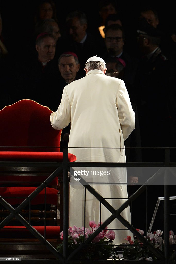 Pope Francis leaves after the Way of the Cross on Good Friday on March 29, 2013 at the Colosseum in Rome. Pope Francis presided over his first Good Friday which will culminate in a torch-lit procession at Rome's Colosseum and prayers for peace in a Middle East 'torn apart by injustice and conflicts'. AFP PHOTO / ALBERTO PIZZOLI