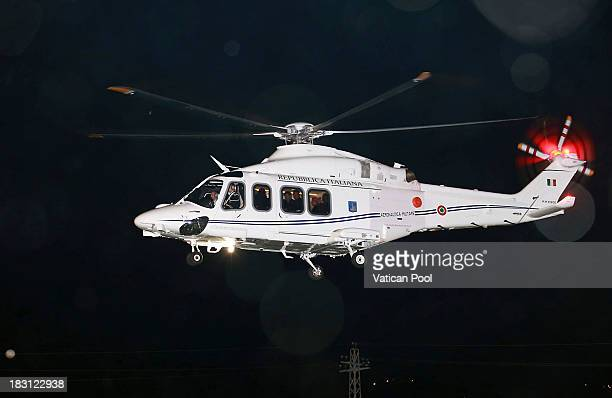 Pope Francis leaves on helicophter Assisi on October 4 2013 in Assisi Italy During the Mass Pope Francis called for an end to armed conflict and...
