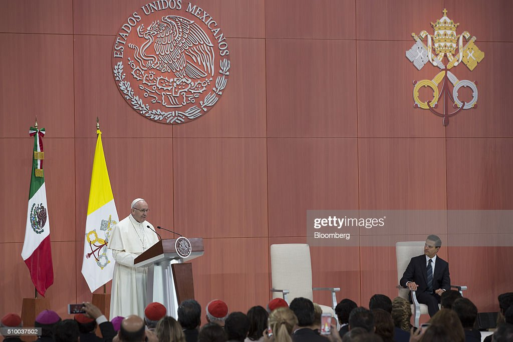 Pope Francis, left, speaks as Enrique Pena Nieto, Mexico's president, listens during the welcoming ceremony at The National Palace in Mexico City, Mexico on Saturday, Feb. 13, 2016. Pope Francis is scheduled to celebrate mass at the Basilica of Guadalupe on Saturday night during his trip to Mexico which runs through Wednesday. Photographer: Susana Gonzalez/Bloomberg via Getty Images