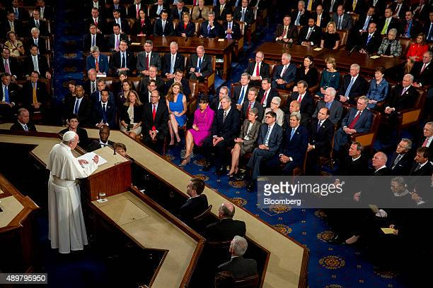 Pope Francis left speaks to a joint meeting of Congress in the House Chamber at the US Capitol in Washington DC US on Thursday Sept 24 2015 Pope...