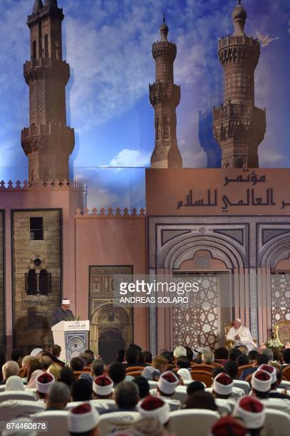Pope Francis listens as Sheikh Ahmed alTayeb the Grand Imam of AlAzhar delivers a speech during a visit to the prestigious Sunni institution in Cairo...