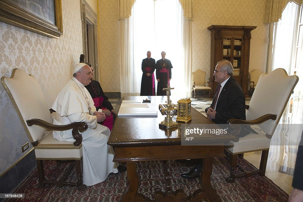 Pope Francis (L) listens to Lebanese President Michel Suleiman during a private audience in the pontiff's library at the Vatican on May 3, 2013.