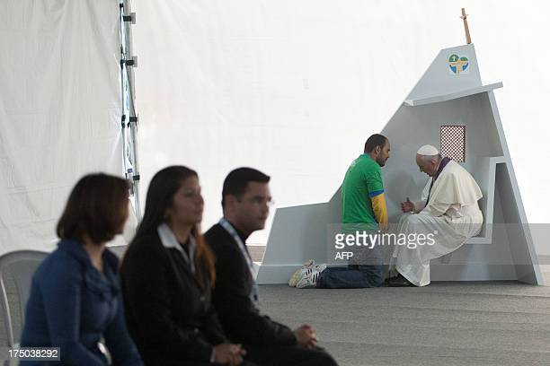 CREDIT 'AFP PHOTO / OSSERVATORE ROMANO' NO Pope Francis listens to the confession of a man in the park of Quinta Da Boa Vista in Rio de Janeiro on...