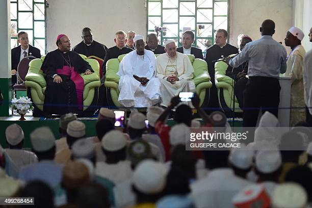 Pope Francis looks on alongside Imam Nehedid Tidjani during a visit to the Central Mosque in Bangui on November 30 2015 Pope Francis said on November...