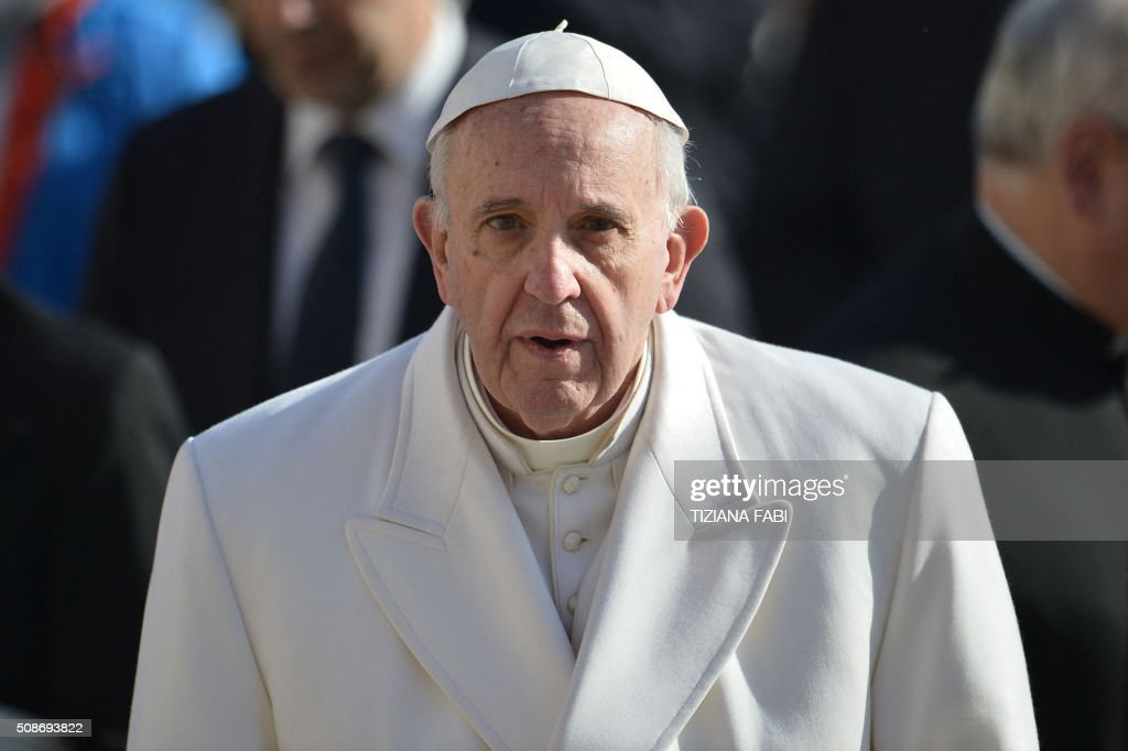 Pope Francis looks on as he arrives for an audience to the Padre Pio Prayer Groups, on February 6, 2016 in Vatican. Pio was revered during his lifetime (1887-1968) and his popularity has continued to grow since his death, particularly in Italy, where mini-statues and pictures of the mystical Capuchin friar are ubiquitous. / AFP / TIZIANA FABI