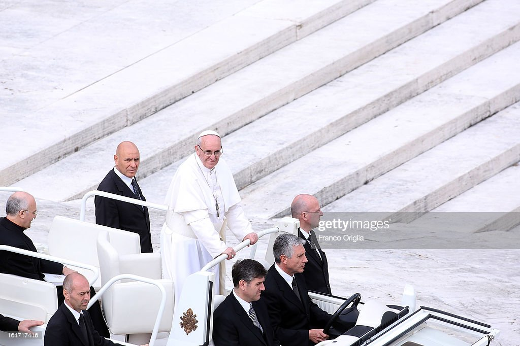 Pope Francis looks on from an open-air jeep, ahead of his first weekly general audience, in St Peter's Square on March 27, 2013 in Vatican City, Vatican.