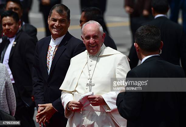 Pope Francis looks on next to Ecuadorean President Rafael Correa at the airport in Quito before his departure for Bolivia on July 8 2015 Pope Francis...