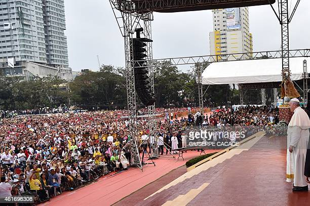 Pope Francis looks out to the crowd during his visit to the University of Santo Tomas in Manila on January 18 2015 Pope Francis will celebrate mass...