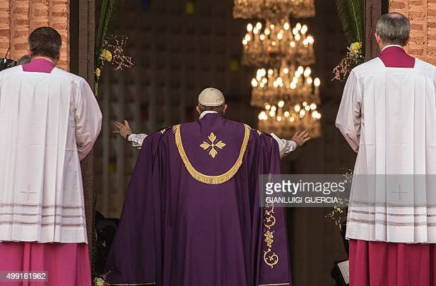 Pope Francis makes a symbolic gesture by opening a 'Holy Door' at Bangui Cathedral in the Central African Republic ahead of the start of a Catholic...