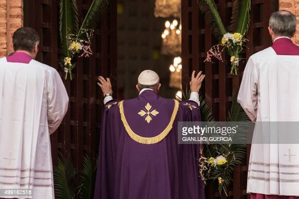CROP*** Pope Francis makes a symbolic gesture by opening a 'Holy Door' at Bangui Cathedral in the Central African Republic ahead of the start of a...