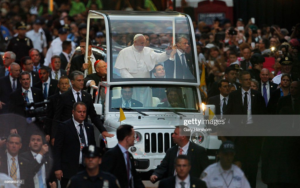 Pope Francis makes his way down Fifth Avenue as he makes his way to St Patrick's Cathedral in New York September 24 2015