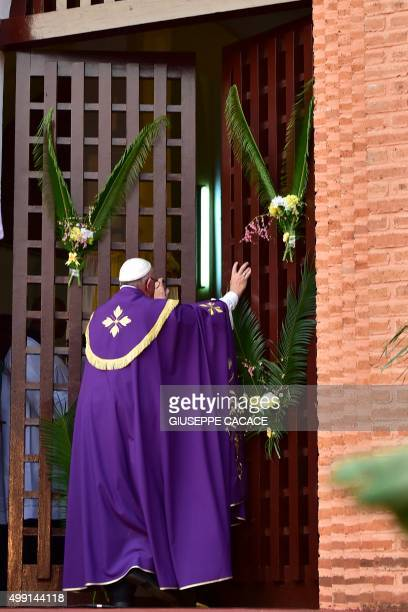 Pope Francis makes the symbolic gesture by opening a 'Holy Door' at Bangui Cathedral on November 29 in the Central African Republic capital Pope...