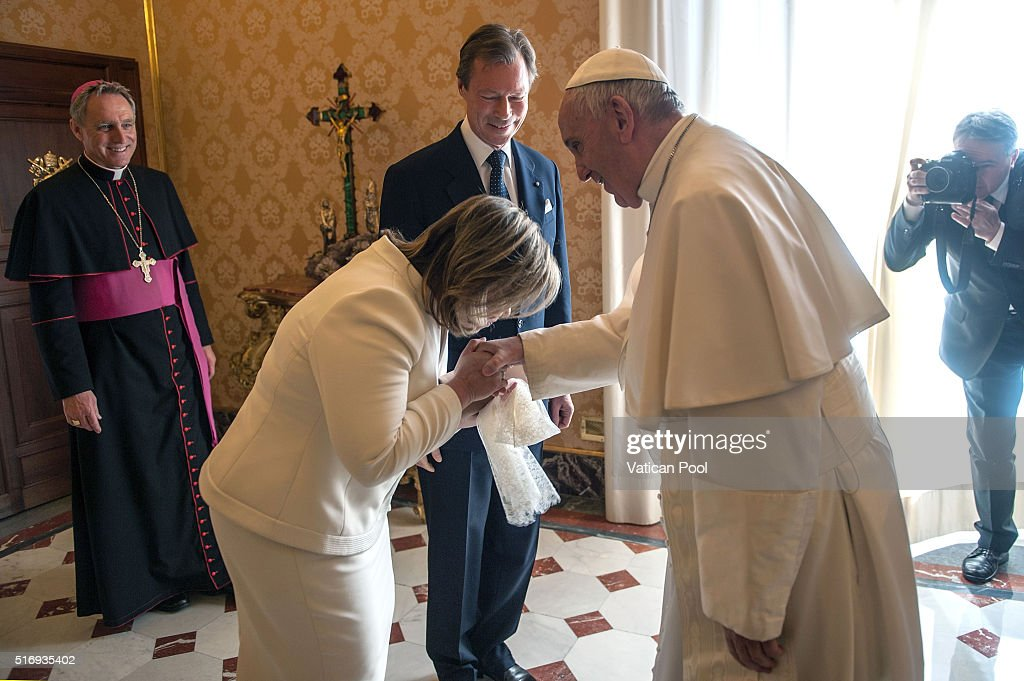 Pope Francis meets Grand Duchess Maria Teresa and Grand Duke Henri of Luxembourg at his private library in the Apostolic Palace on March 21, 2016 in Vatican City, Vatican. During the audience the Royal Family of Luxembourg gave the Holy Father a family portrait, with the Spanish-language dedication, 'To our Pope Francis, with the respectful and filial affection our whole family.' Pope Francis gave the family a medal of the pontificate and copies of his Apostolic Exhortation, Evangelii gaudium, and his Encyclical Letter, Laudato siÕ.