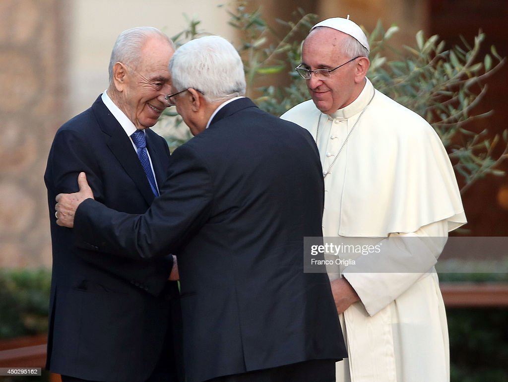Pope Francis (R) meets Israeli President Shimon Peres and Palestinian President <a gi-track='captionPersonalityLinkClicked' href=/galleries/search?phrase=Mahmoud+Abbas&family=editorial&specificpeople=176534 ng-click='$event.stopPropagation()'>Mahmoud Abbas</a> for a peace invocation prayer at the Vatican Gardens on June 8, 2014 in Vatican City, Vatican. Pope Francis invited Israeli President Shimon Peres and Palestinian President <a gi-track='captionPersonalityLinkClicked' href=/galleries/search?phrase=Mahmoud+Abbas&family=editorial&specificpeople=176534 ng-click='$event.stopPropagation()'>Mahmoud Abbas</a> to the encounter on May 25th during his visit to the Holy Land.