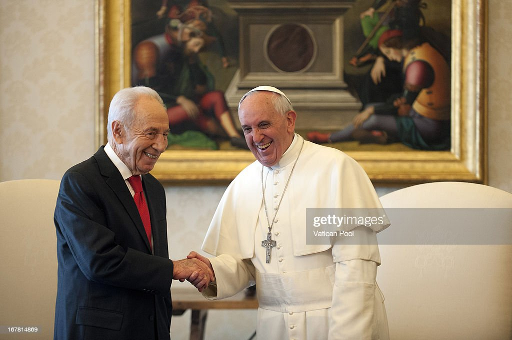 Pope Francis (R) meets Israeli president <a gi-track='captionPersonalityLinkClicked' href=/galleries/search?phrase=Shimon+Peres&family=editorial&specificpeople=201775 ng-click='$event.stopPropagation()'>Shimon Peres</a> (L) during an audience at his private library on April 30, 2013 in Vatican City, Vatican. The Pontiff and President <a gi-track='captionPersonalityLinkClicked' href=/galleries/search?phrase=Shimon+Peres&family=editorial&specificpeople=201775 ng-click='$event.stopPropagation()'>Shimon Peres</a> debated on a variety of issues concerning the Middle East during their meeting.