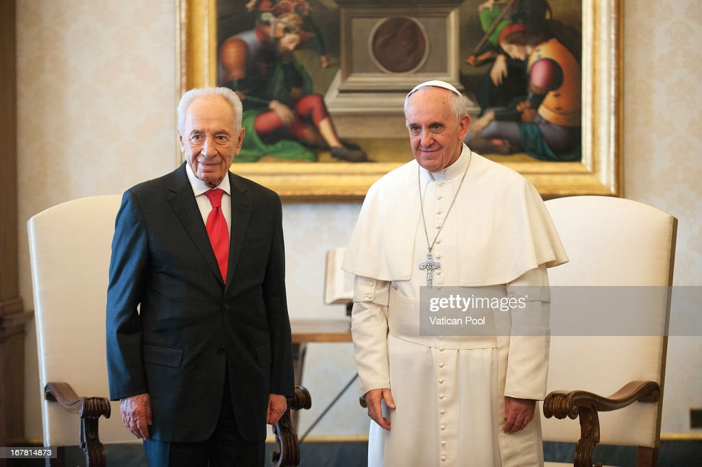 <a gi-track='captionPersonalityLinkClicked' href=/galleries/search?phrase=Pope+Francis&family=editorial&specificpeople=2499404 ng-click='$event.stopPropagation()'>Pope Francis</a> (R) meets Israeli president <a gi-track='captionPersonalityLinkClicked' href=/galleries/search?phrase=Shimon+Peres&family=editorial&specificpeople=201775 ng-click='$event.stopPropagation()'>Shimon Peres</a> (L) during an audience at his private library on April 30, 2013 in Vatican City, Vatican. The Pontiff and President <a gi-track='captionPersonalityLinkClicked' href=/galleries/search?phrase=Shimon+Peres&family=editorial&specificpeople=201775 ng-click='$event.stopPropagation()'>Shimon Peres</a> debated on a variety of issues concerning the Middle East during their meeting.