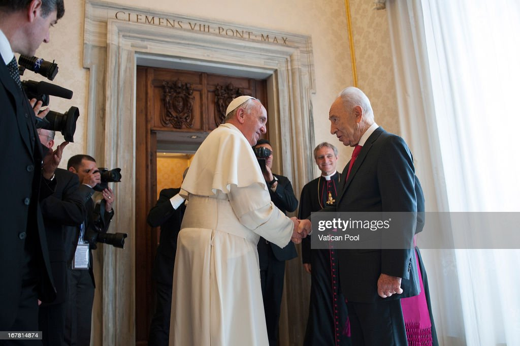 Pope Francis (L) meets Israeli president <a gi-track='captionPersonalityLinkClicked' href=/galleries/search?phrase=Shimon+Peres&family=editorial&specificpeople=201775 ng-click='$event.stopPropagation()'>Shimon Peres</a> (R) during an audience at his private library on April 30, 2013 in Vatican City, Vatican. The Pontiff and President <a gi-track='captionPersonalityLinkClicked' href=/galleries/search?phrase=Shimon+Peres&family=editorial&specificpeople=201775 ng-click='$event.stopPropagation()'>Shimon Peres</a> debated on a variety of issues concerning the Middle East during their meeting.