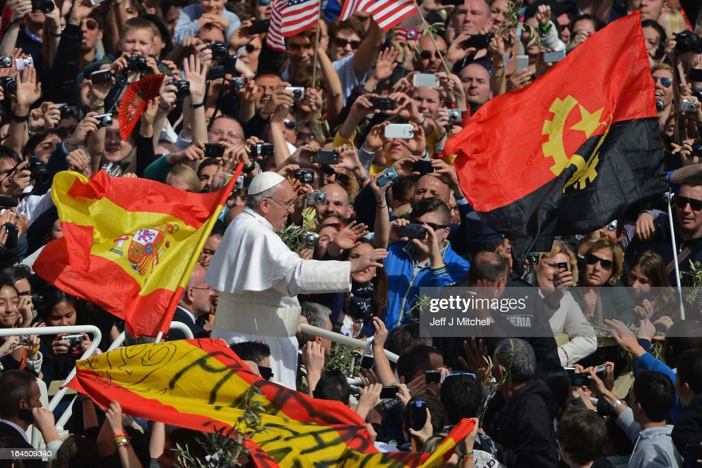 <a gi-track='captionPersonalityLinkClicked' href=/galleries/search?phrase=Pope+Francis&family=editorial&specificpeople=2499404 ng-click='$event.stopPropagation()'>Pope Francis</a> meets pilgrims as he drives around St Peter's Square following the Palm Sunday Mass on March 24, 2013 in Vatican City, Vatican. <a gi-track='captionPersonalityLinkClicked' href=/galleries/search?phrase=Pope+Francis&family=editorial&specificpeople=2499404 ng-click='$event.stopPropagation()'>Pope Francis</a> lead his first mass of Holy Week as pontiff by celebrating Palm Sunday in front of thousands of faithful and clergy. The pope's first holy week will also incorporate him washing the feet of prisoners in a youth detention centre in Rome next Thursday, March 28.