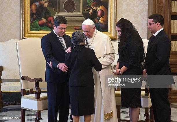 Pope Francis meets President of Honduras Juan Orlando Hernandez Alvarado and his wife Ana Garcia at his private library in the Apostolic Palace on...
