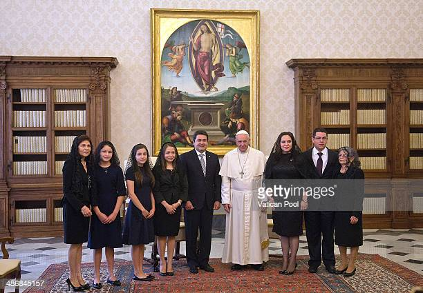 Pope Francis meets President of Honduras Juan Orlando Hernandez Alvarado his wife Ana Garcia his family and his delegation at his private library in...