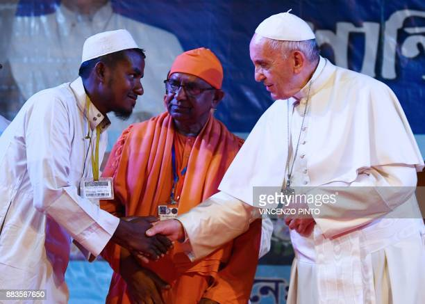 Pope Francis meets with a Rohingya refugee during an interreligious meeting in Dhaka on December 1 2017 Pope Francis arrived in Bangladesh from...