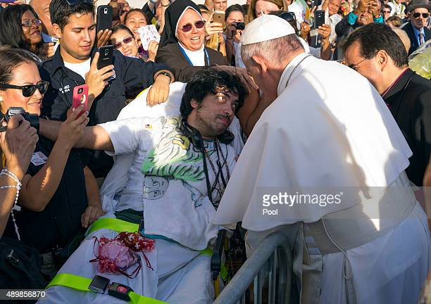 Pope Francis meets with Gerard Gubatan of Brooklyn during his arrival at John F Kennedy International Airport September 24 2015 in New York City The...