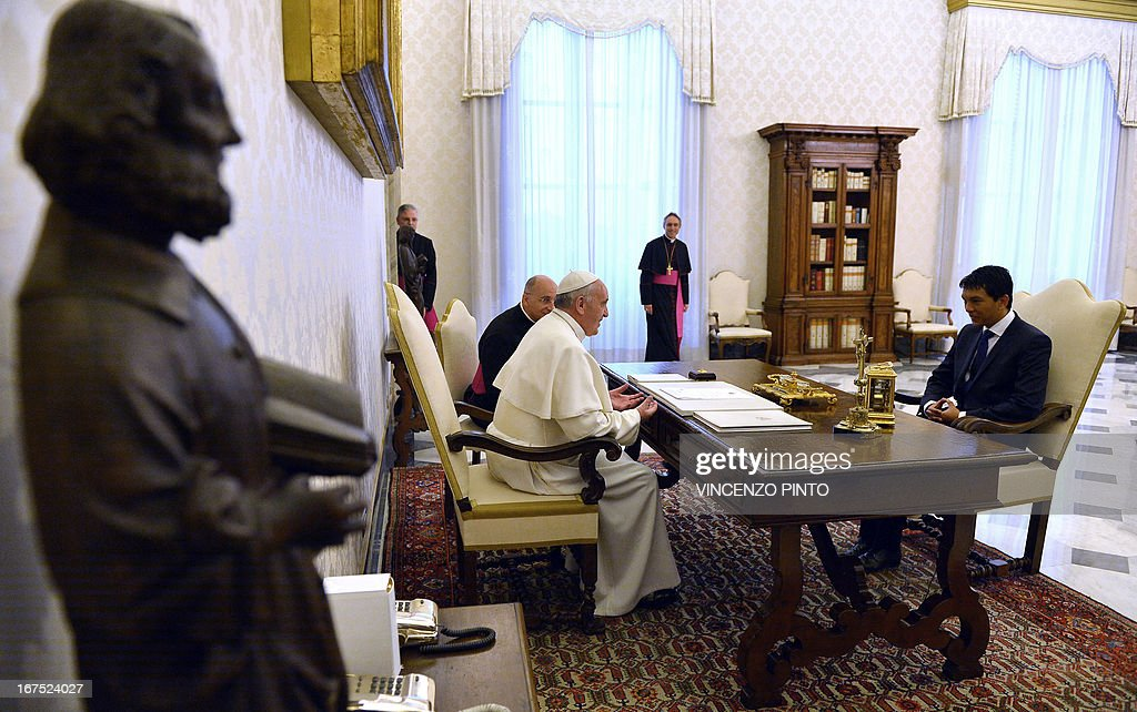 Pope Francis meets with Madagascar's transitional leader Andry Rajoelina (R) during a private audience at the Vatican on April 26, 2103.