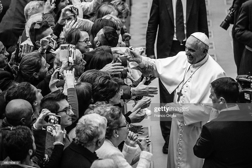 Pope Francis meets with Vatican employees and their families at the Paul VI Hall on December 22 2014 in Vatican City Vatican