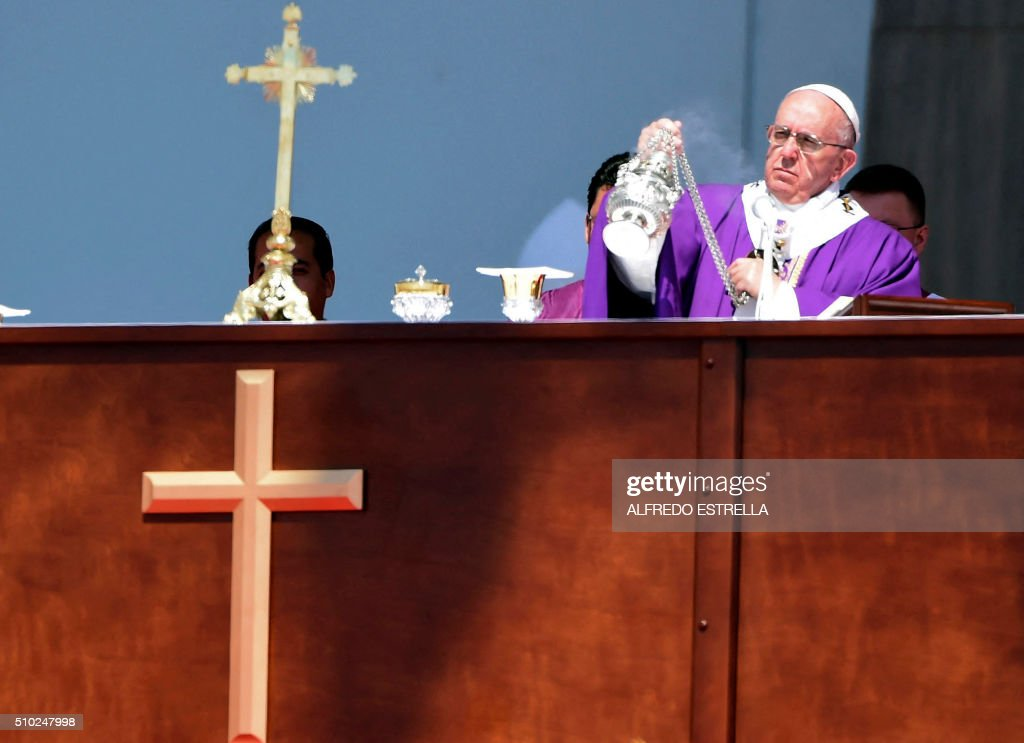 Pope Francis officiates an open-air mass in Ecatepec, near Mexico City, on February 14, 2016. Pope Francis urged Mexicans on Sunday to turn their country into a land of opportunity where there is no need to emigrate or mourn victims 'of the merchants of death.' AFP PHOTO/ALFREDO ESTRELLA / AFP / ALFREDO ESTRELLA