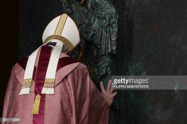 Pope Francis opens a 'Holy Door' at St John in Lateran basilica on December 13 2015 at the Vatican From a village church in Iraq to a prison in Rome...