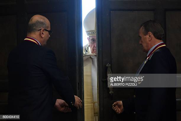 Pope Francis opens a 'Holy Door' at St Peter's basilica to mark the start of the Jubilee Year of Mercy on December 8 2015 in Vatican In Catholic...