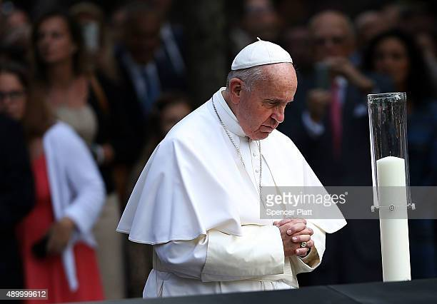 Pope Francis pauses to pray during a visit to the 9/11 memorial pools on September 25 2015 in New York City Pope Francis visited Ground Zero...